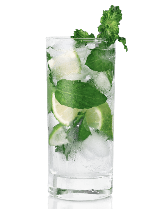 Mojito cocktail over ice with fresh mint an limes in a tall Collins glass