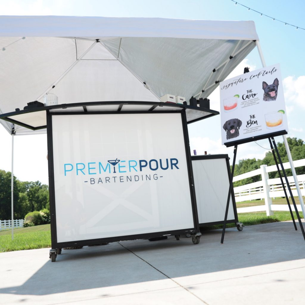 Premier Pour Bartending white mobile bar on the patio at The Stables on Obee ready for a weddding