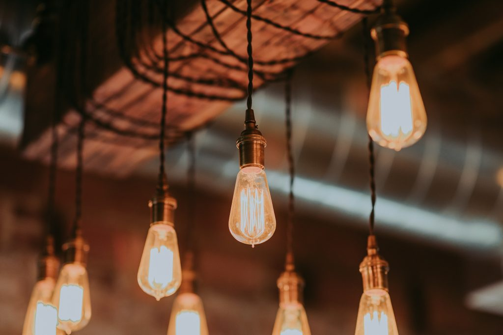 Edison bulbs hanging from a wooden beam.