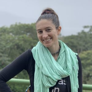Our bartender Ashley smiling in front of a Costa Rican landscape.