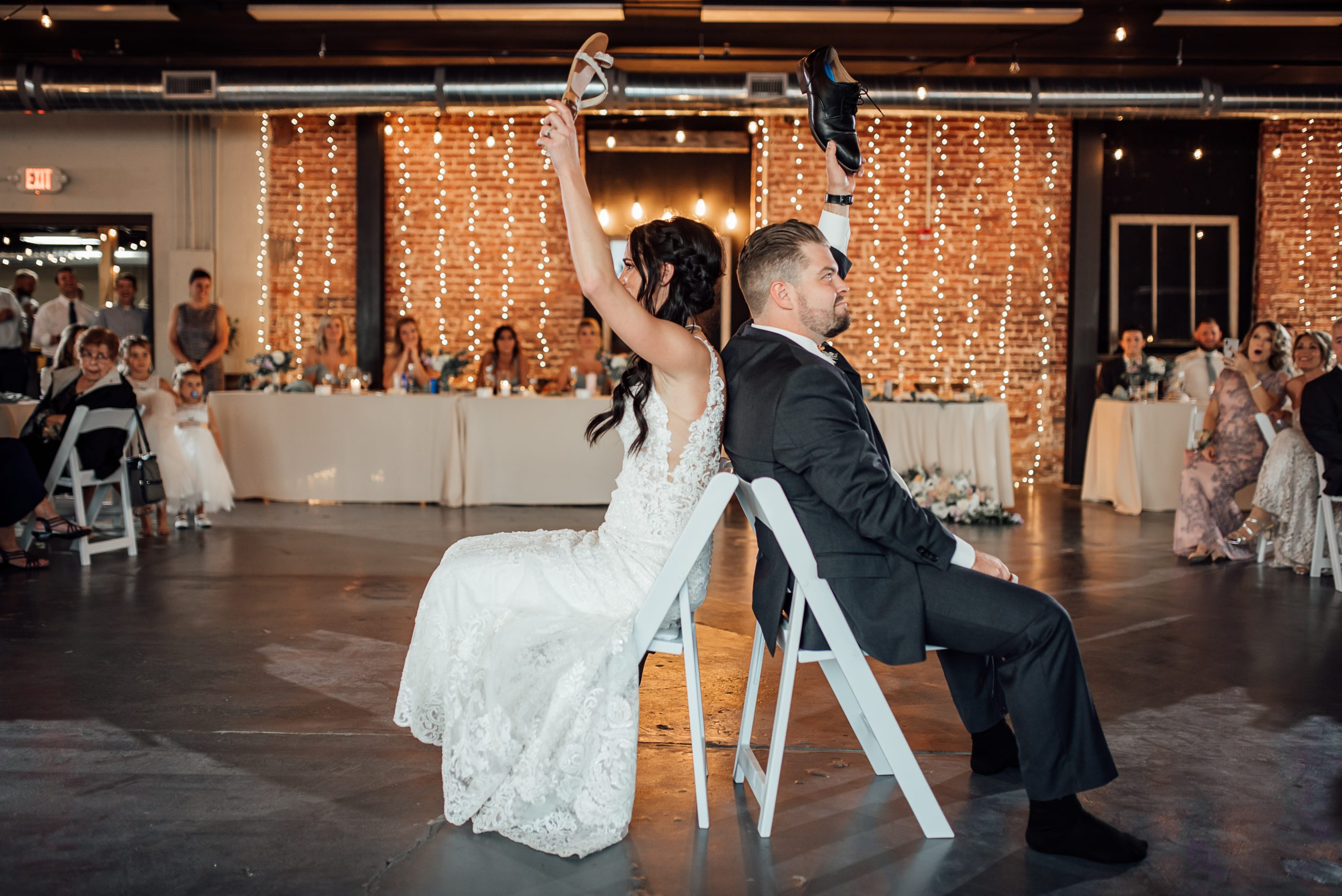 Bride and groom playing games on the dance floor at The Venues Toledo.