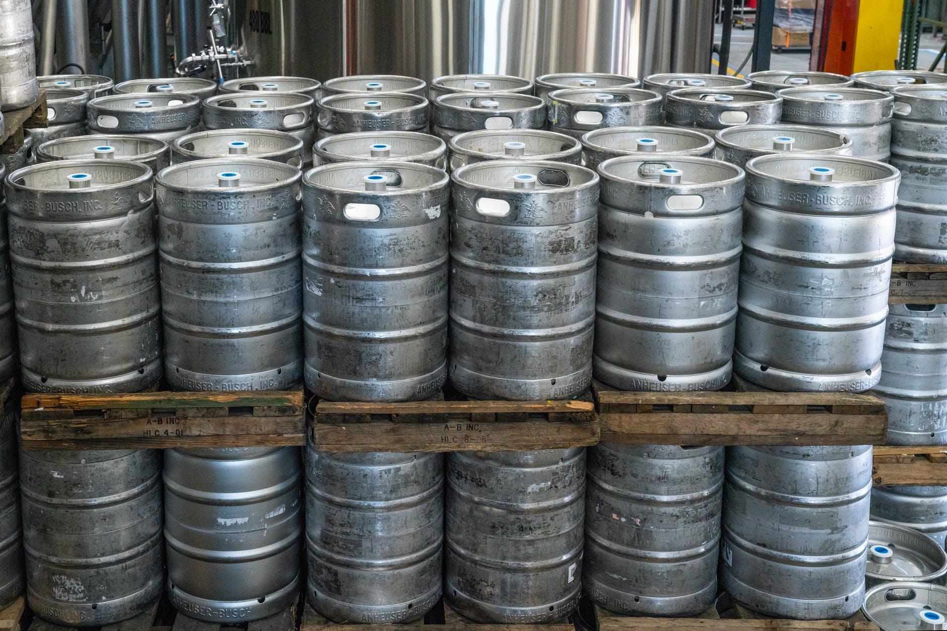 pile of cylinder silver keg tank lot